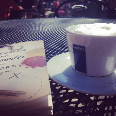 soaking up some rays while enjoying a cappuccino + book club read
